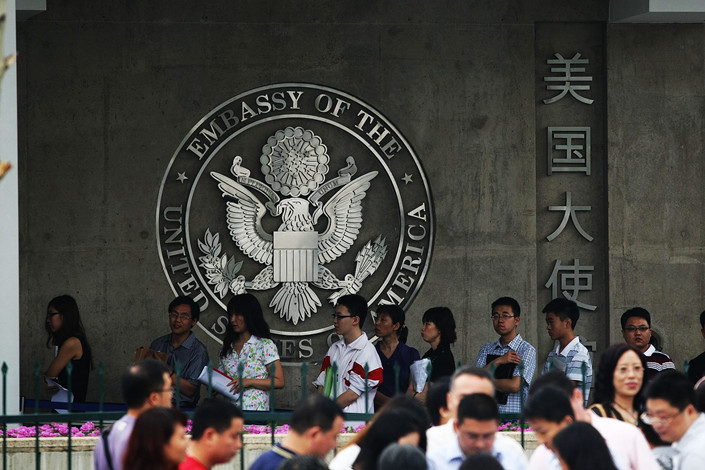 Visa applicants wait in line outside the U.S. embassy in Beijing in June 2012. Photo: VCG