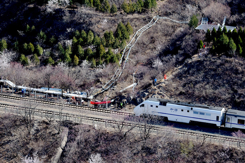 Construction underway on a trackside boardwalk near the mountain pass, March 23. Photo: IC