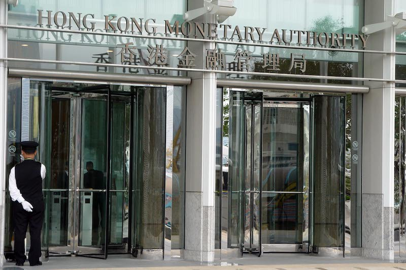 The Hong Kong Monetary Authority (above) hands out the first three licenses for virtual banking services in the city. Photo: VCG