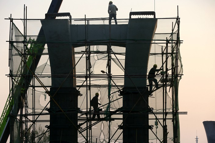 Construction workers labor on a site in Huai'an, in eastern China's Jiangsu province, on Oct. 4, 2018. Photo: IC