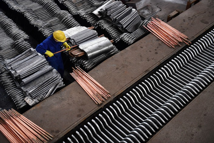 A worker prepares lead and zinc rods at a production workshop in South China's Hunan province on March 23. Photo: IC