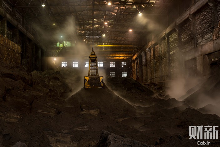 Stacks of cobalt salt cool at a warehouse in Northwest China's Gansu province on Dec. 3. Photo: Chen Liang/Caixin