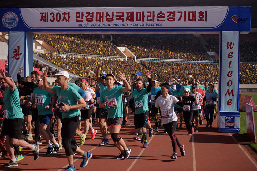 Foreign competitors cross the starting line during the annual Mangyongdae Prize International Marathon, at Kim Il Sung Stadium in Pyongyang, North Korea, on April 7. The event, also known as the Pyongyang Marathon, is the highlight of the country's tourism calendar and offers the chance to run or jog through the streets of the tightly-controlled city. Photo: VCG_Gallery: Racing in Pyongyang