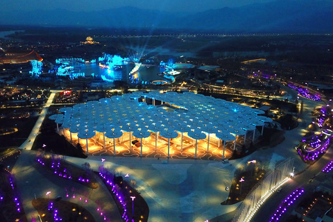The lights of the flower-shaped international pavilion are tested on Monday night. Photo: VCG