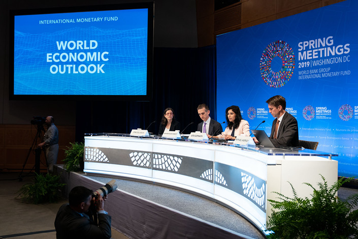 Gita Gopinath, IMF chief economist (second right), speaks at a World Economic Outlook news conference during the spring meetings of the IMF and World Bank in Washington on Tuesday. Photo: VCG