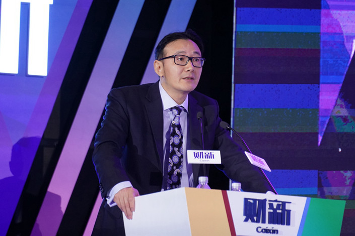 Xu Zhong speaks at the 9th Caixin Summit on Nov. 20. Photo: Caixin