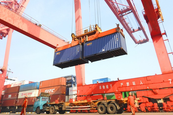 Shipping containers full of export goods get unloaded on March 8 at a port in Lianyungang, East China's Jiangsu province. Photo: IC