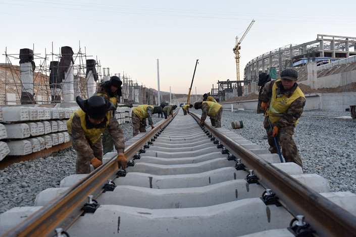 Workers lay railway tracks in Zhangjiakou, North China's Hebei province on Dec. 18. Photo: IC