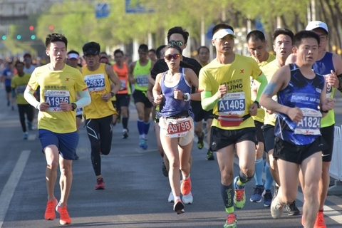 Runners during the Beijing Half Marathon on Sunday. Photo: IC