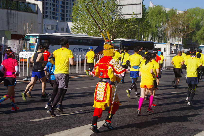 A runner dressed as Sun Wukong, a character from a Chinese literary classic also known as the Monkey King, during the marathon on Sunday. Photo: IC_Gallery: Running From Tiananmen to the Bird's Nest