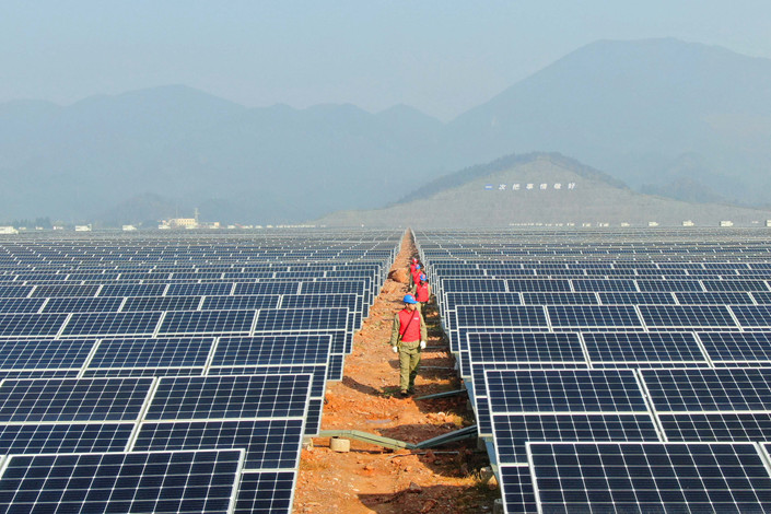 A solar power station is inspected in Xianning, Central China's Hubei province on Jan. 23. Photo: IC