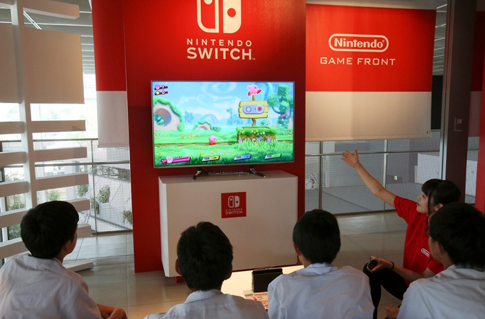 Visitors to a Tokyo showroom play a Nintendo Switch game on June 19. Photo: IC