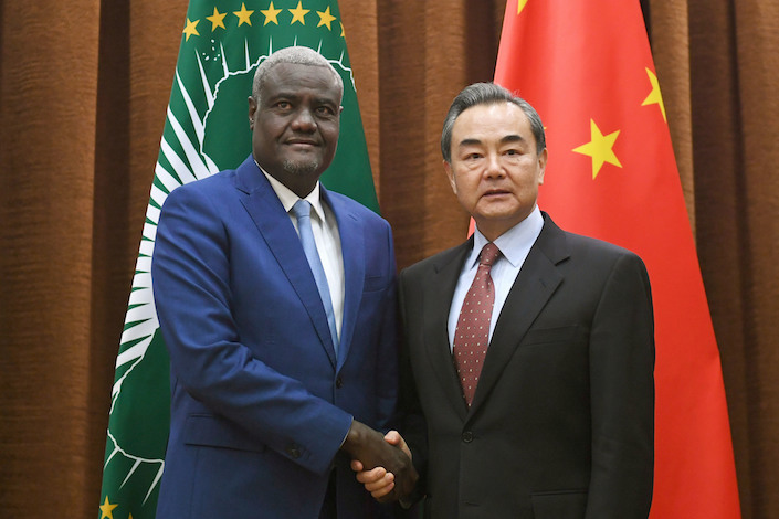 Chinese Foreign Minister Wang Yi meets chairman of the African Union Commission, Moussa Faki Mahamat, on Feb. 8, 2018, prior to a meeting in Beijing. Photo: IC