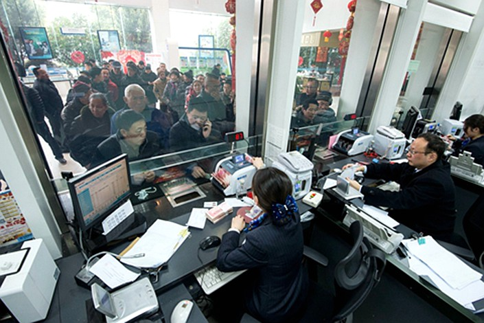 Multiple banks in the rich province of Zhejiang have started to list credit overdue for over 60 days as nonperforming loans to better reflect their asset quality. Photo: IC