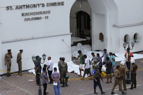 Worker lay out the corpses that still need to be identified outside of St Anthony's Shrine on Sunday. The shrine was one of several places of worship that were bombed in Sri Lanka on Easter, Christianity's most important holiday. Photo: IC