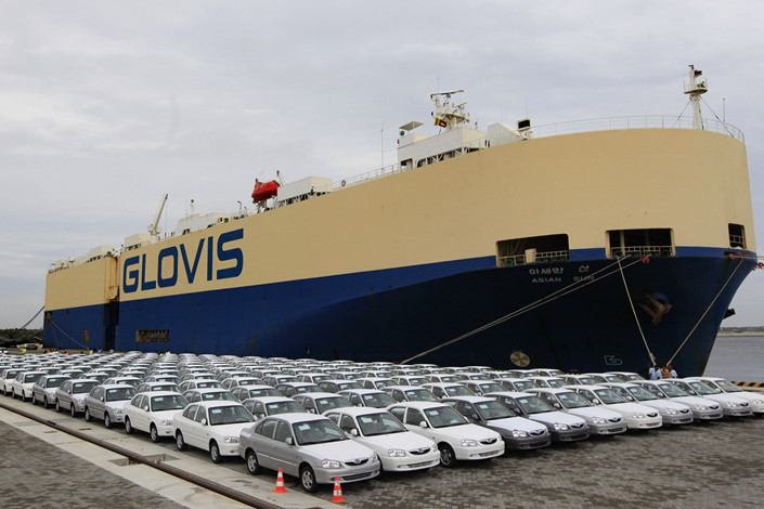 Hyundai cars manufactured in India are parked after being unloaded from the carrier ship Asian Sun at Hambantota Port, Sri Lanka on June 6, 2012. Photo: IC