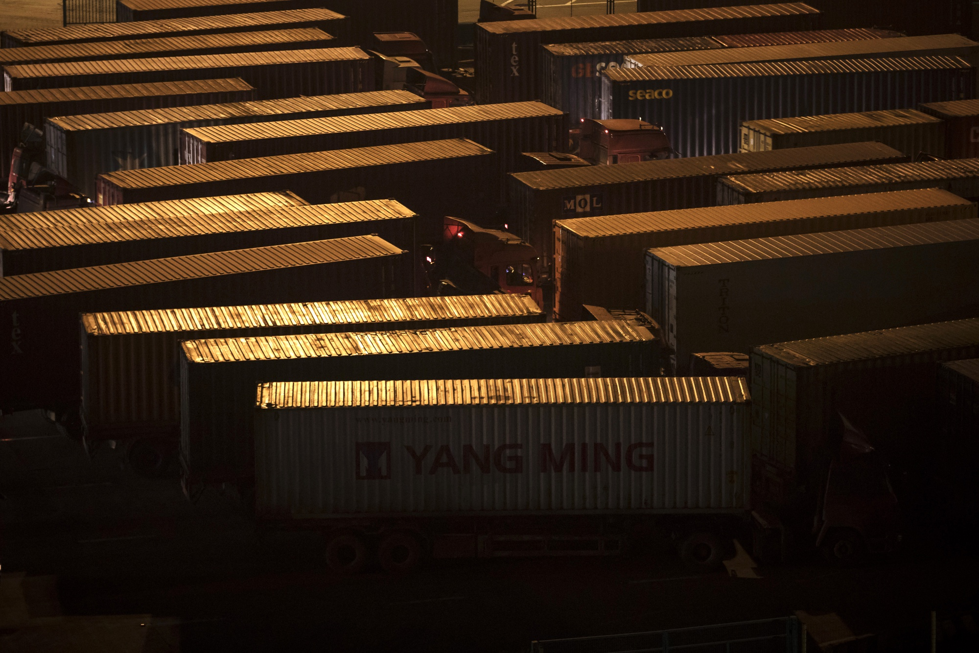 Trucks sit parked at Shanghai's Yangshan Deepwater Port. Photo: Bloomberg