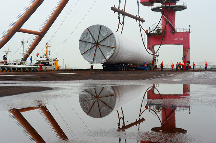 A Chinese manufactured component of an offshore wind turbine gets lifted at a port in the eastern city of Nanjing on Tuesday. Photo: IC Photo