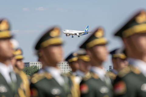A plane carrying Laos' President Ben Yang arrives in Beijing on April 25. Photo: IC Photo