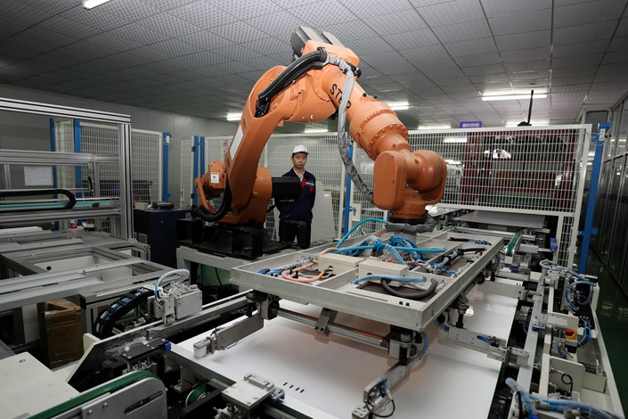 Robots work on the production line of a solar panel factory in Quanjiao county, Anhui province, on April 25. Photo: IC Photo