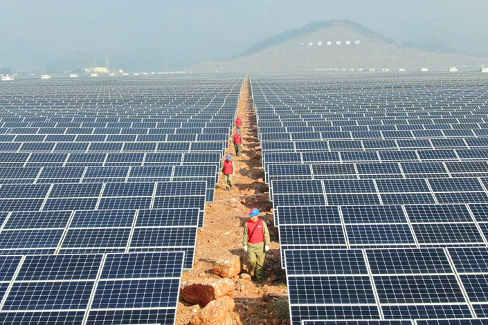 Technicians inspect a photovoltaic power station in Xianning in Hubei province. Photo: IC Photo