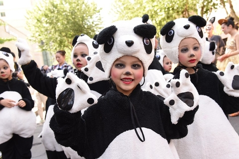 Children dressed as pandas take part in a parade for the animation festival. Photo: IC Photo