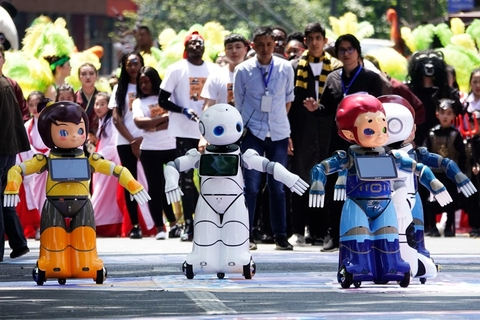 Robots dance during the parade. Photo: IC Photo