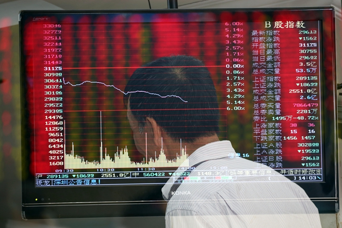 A man is seen in front of a screen displaying the prices of shares at a brokerage in Nanjing, Jiangsu province, on May 6, 2019. Photo: IC Photo