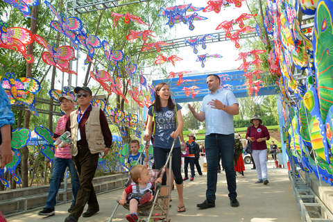 Visitors walk through a kite gallery. Photo: IC Photo