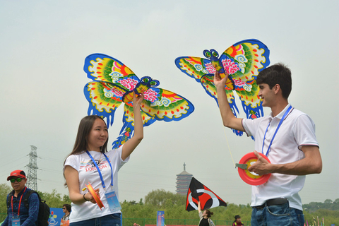 Two participants hold up traditional Chinese kites at the festival. Photo: IC Photo