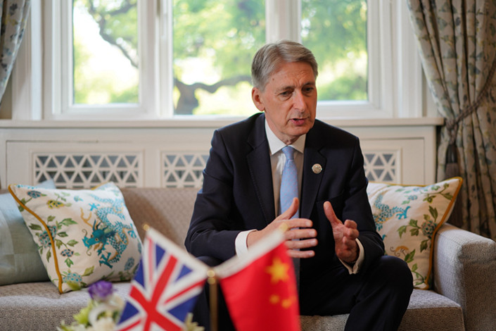 Philip Hammond, special envoy of the British prime minister and chancellor of the exchequer, speaks to Caixin on April 26. Photo: Cai Yingli/Caixin