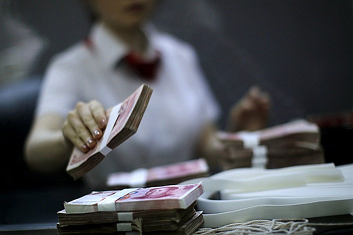 Total social financing includes financing that exists outside the conventional bank lending system, such as initial public offerings, loans from trust companies and bond sales. Photo: VCG