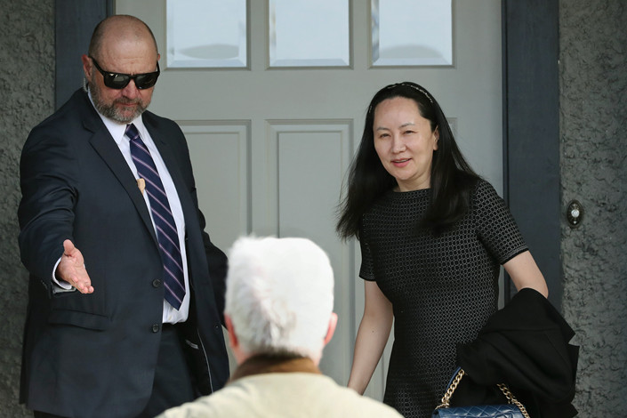 Huawei Chief Financial Officer Meng Wanzhou (right) is escorted by court-appointed security as she leaves her home Wednesday for a court hearing in Vancouver. Photo: UPI/IC Photo