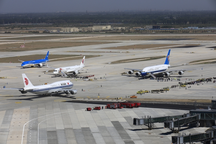 Four planes sit on the tarmac at Beijing Capital International Airport on Monday morning ahead of their test flights to the city's new airport in Daxing district. Photo: VCG_Gallery: Flagship Flights Land at Beijing's New Airport