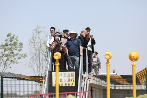 Onlookers gather to watch the test flights. Photo: IC Photo