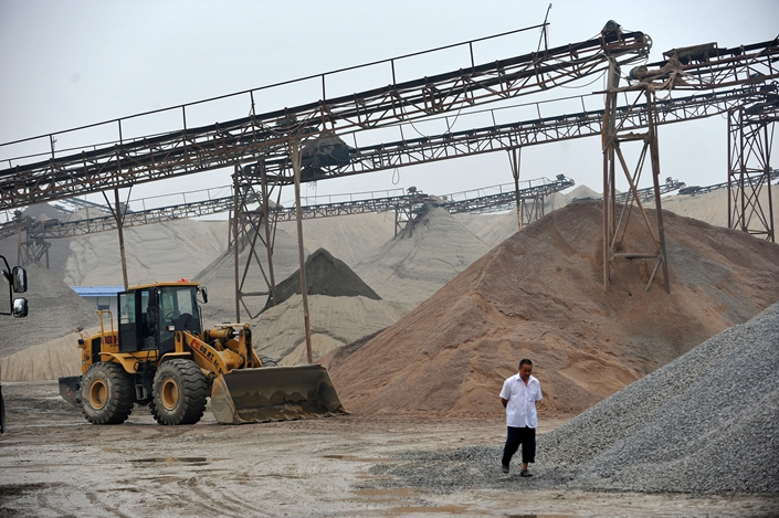 A sand and gravel plant on the Yangtze river in Wuhan, Hubei province in May 2015. Photo: VCG