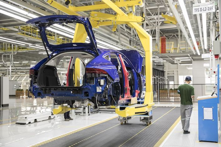 A Jaguar E-Pace compact sport utility vehicle (SUV) moves along a conveyor on the production line at the second phase of the Chery Jaguar Land Rover Automotive Co. plant in Changshu