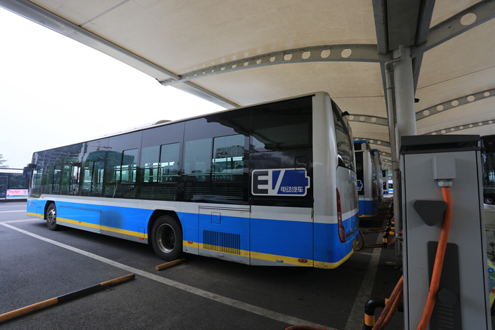 An electric bus parked at a bus station in Beijing in August 2017. Photo: IC Photo