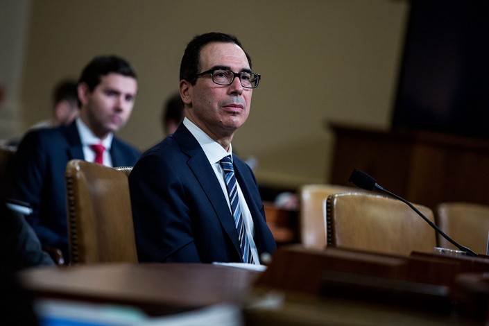 U.S. Treasury Secretary Steven Mnuchin appears before a House Ways and Means Committee hearing in Washington on March 14. Photo: VCG
