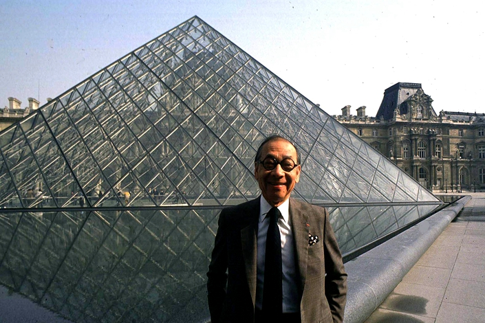 I.M. Pei is seen next to the iconic glass pyramid of the Louvre in Paris, which was completed in 1989. Photo: IC Photo