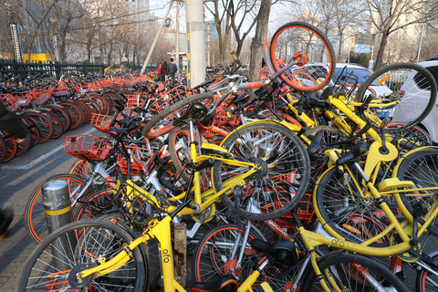 Hundreds of shared bikes are piled up on the sidewalk outside the Lianhuachi long-distance bus station in Beijing on Feb. 21 2018. Photo: IC Photo