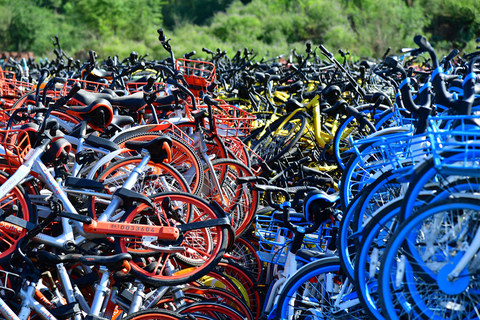A large number of shared bikes piled up near a village in Fengtai district, Beijing, on June 14, 2018. Photo: IC Photo