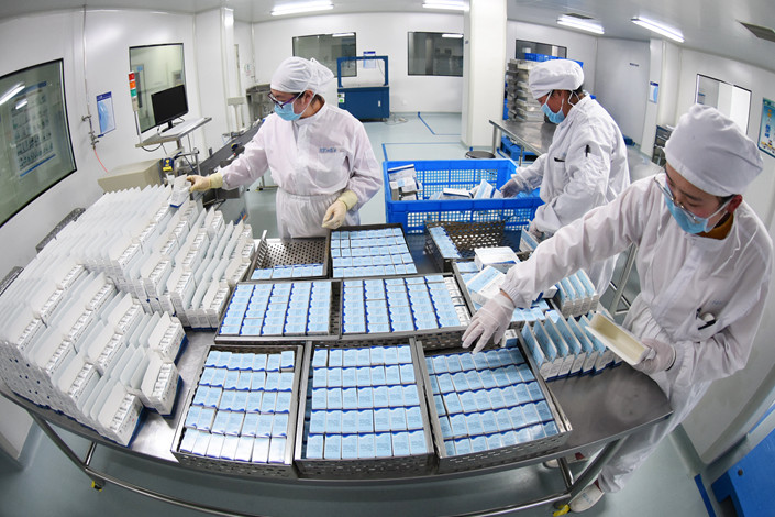 Workers package anti-tumor drugs at a pharmaceutical company in the eastern city of Lianyungang on March 13. Photo: IC Photo