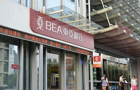 Hong Kong Banking Tycoon Passes Baton to Two Sons