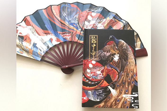 Tang Xin created merchandise, including a folding fan, to accompany her book,