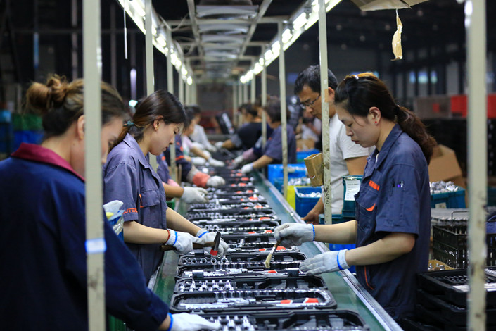Employees work at a tool manufacturer in East China's Jiangsu province on May 26. Photo: IC Photo