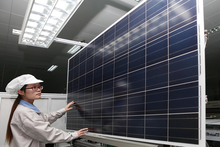 Workers at an energy company in Jiangsu province produce solar panels for export to Europe and the United States, May 20, 2018. Photo: VCG