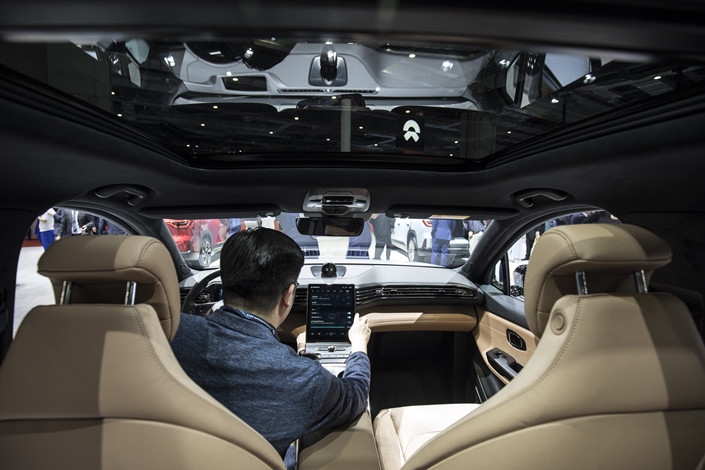Inside the Shanghai Auto Show. Photo: Bloomberg
