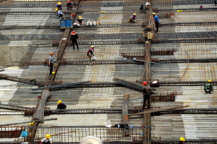 A crew works at a construction site in East China's Fujian province on March 14. Photo: VCG
