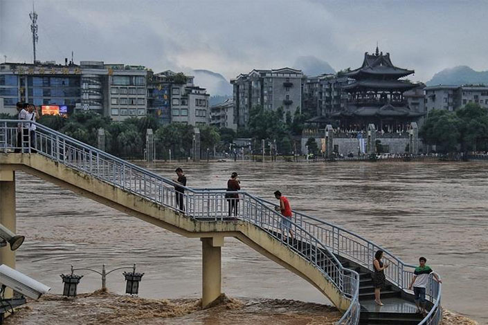 On Sunday, floodwaters from the Lijiang River filled streets, soaked factory buildings and fields, damaged houses, caused blackouts and disrupted communications in some townships in Guilin in the Guangxi Zhuang autonomous region. Photo: VCG